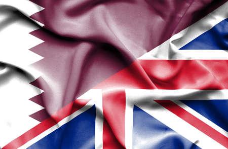 united kingdom: Waving flag of United Kingdom and Qatar Stock Photo