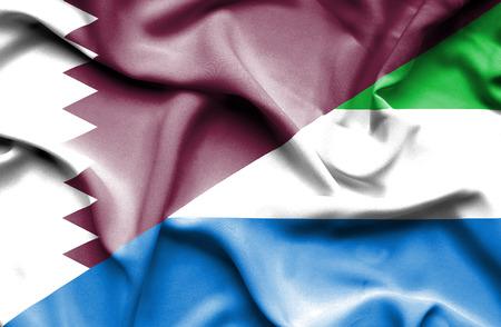 sierra leone: Waving flag of Sierra Leone and Qatar