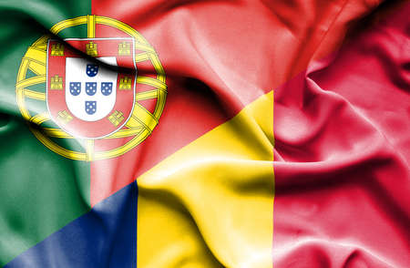 portugese: Waving flag of Chad and Portugal Stock Photo