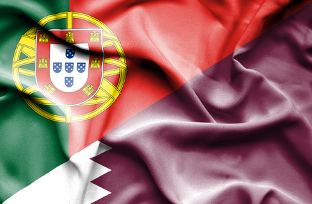 portugese: Waving flag of Qatar and Portugal Stock Photo