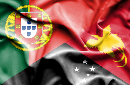 portugese: Waving flag of Papua New Guinea and Portugal Stock Photo