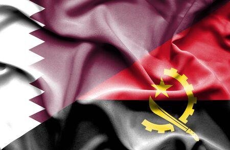 angola: Waving flag of Angola and Qatar Stock Photo