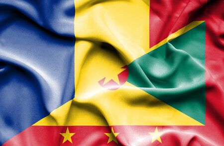 guernsey: Waving flag of Guernsey and Romania Stock Photo