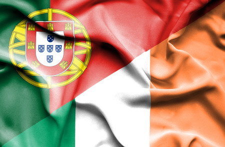 portugese: Waving flag of Ireland and Portugal Stock Photo