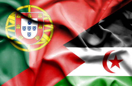 portugese: Waving flag of Western Sahara and Portugal Stock Photo