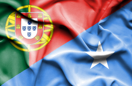 somalian culture: Waving flag of Somalia and Portugal Stock Photo