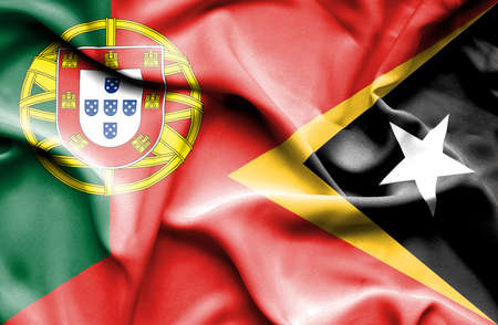 timor: Waving flag of East Timor and Portugal Stock Photo