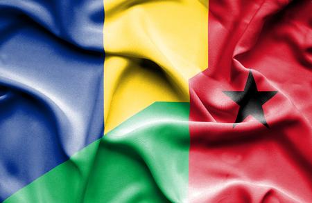 guinea bissau: Waving flag of Guinea Bissau and Romania