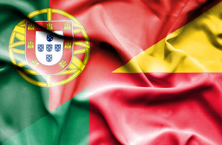 portugese: Waving flag of Benin and Portugal Stock Photo