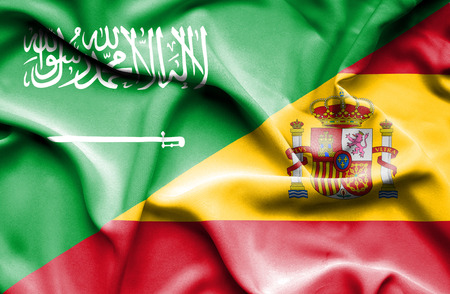 Waving flag of Spain and Saudi Arabia