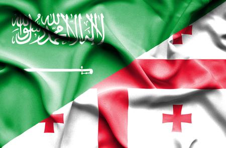 saudi arabia: Waving flag of Georgia and Saudi Arabia