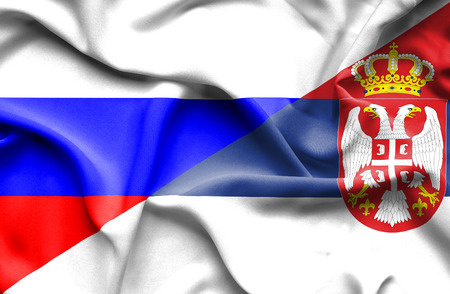 serbia: Waving flag of Serbia and Russia Stock Photo