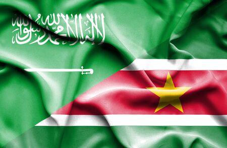 saudi: Waving flag of Suriname and Saudi Arabia Stock Photo