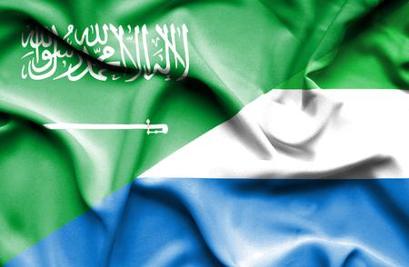 leone: Waving flag of Sierra Leone and Saudi Arabia