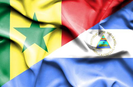 nicaragua: Waving flag of Nicaragua and Senegal