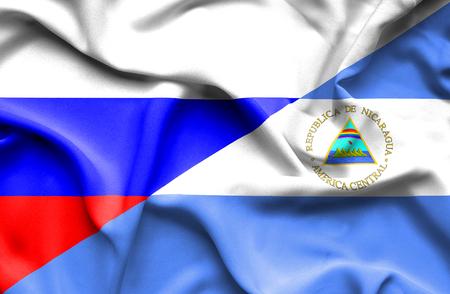 nicaragua: Waving flag of Nicaragua and Russia Stock Photo