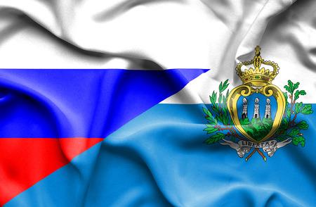 marino: Waving flag of San Marino and Russia Stock Photo