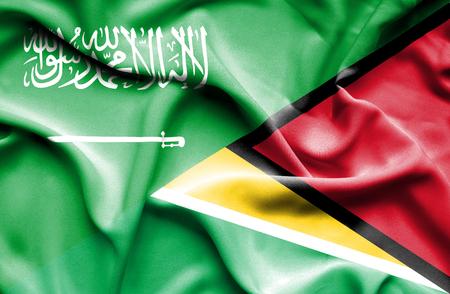 saudi arabia: Waving flag of Guyana and Saudi Arabia