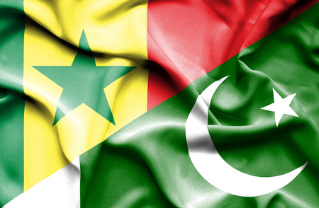 senegal: Waving flag of Pakistan and Senegal Stock Photo