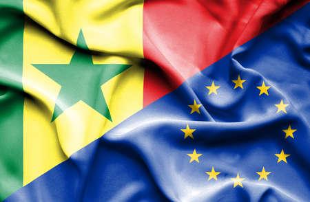 european union: Waving flag of European Union and Senegal Stock Photo
