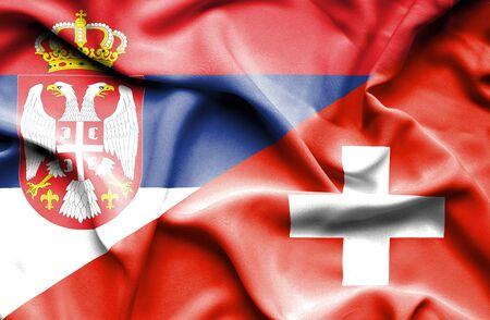 serbia: Waving flag of Switzerland and Serbia Stock Photo