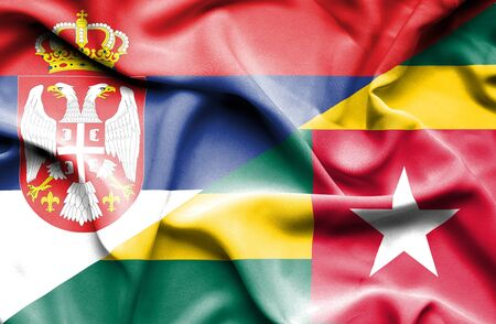 serbia: Waving flag of Togo and Serbia