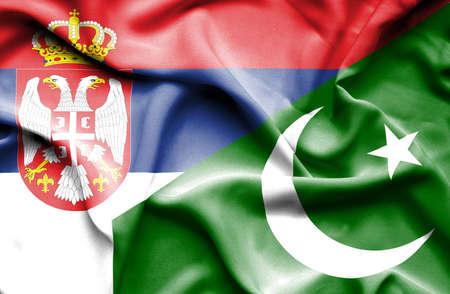 serbia: Waving flag of Pakistan and Serbia Stock Photo