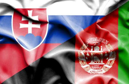 slovak: Waving flag of Afghanistan and Slovak Stock Photo