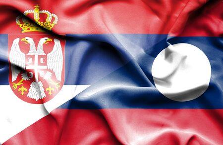laos: Waving flag of Laos and Serbia