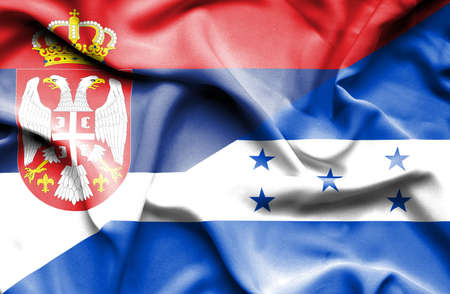 honduras: Waving flag of Honduras and Serbia Stock Photo