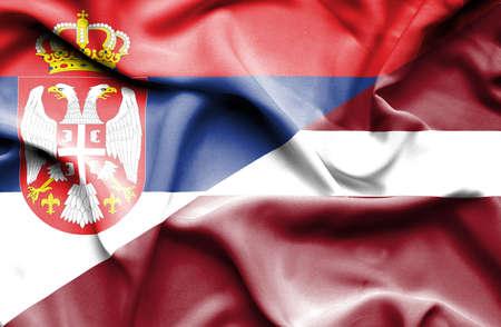 serbia: Waving flag of Latvia and Serbia