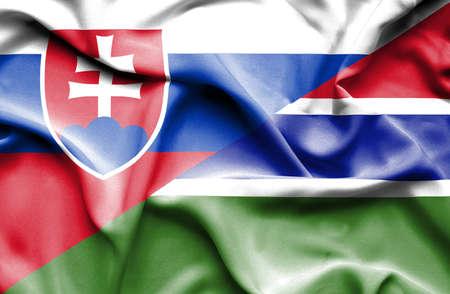 slovak: Waving flag of Gambia and Slovak Stock Photo