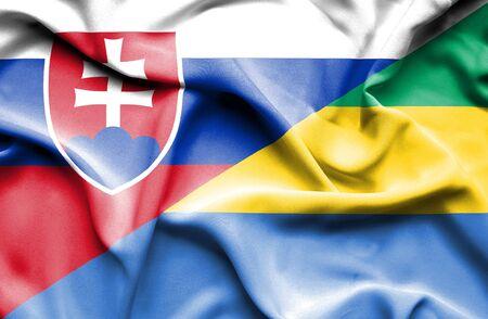 slovak: Waving flag of Gabon and Slovak Stock Photo