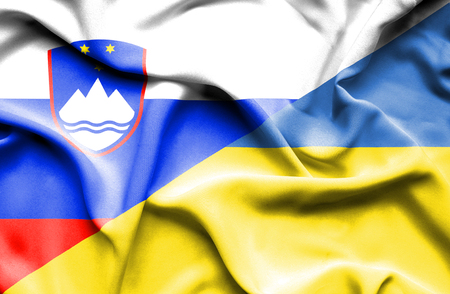 slovenia: Waving flag of Ukraine and Slovenia Stock Photo