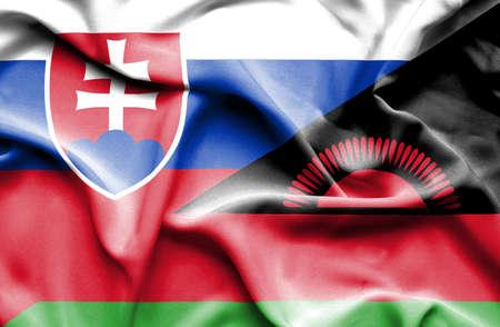 malawi: Waving flag of Malawi and Slovak