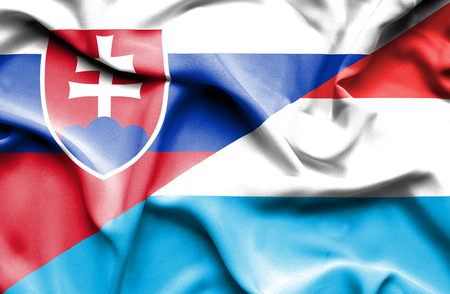slovak: Waving flag of Luxembourg and Slovak