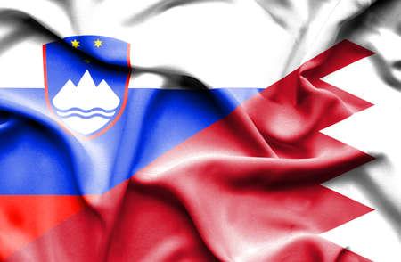 bahrain money: Waving flag of Bahrain and Slovenia Stock Photo