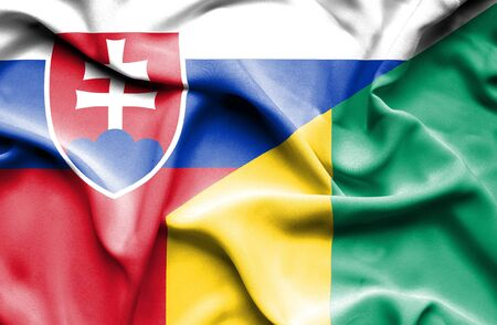 slovak: Waving flag of Guinea and Slovak Stock Photo
