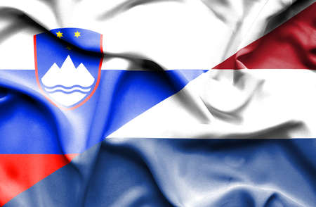 slovenia: Waving flag of Netherlands and Slovenia
