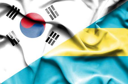 bahamas: Waving flag of Bahamas and South Korea Stock Photo