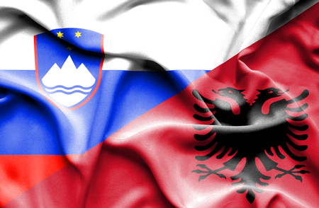 albania: Waving flag of Albania and Slovenia
