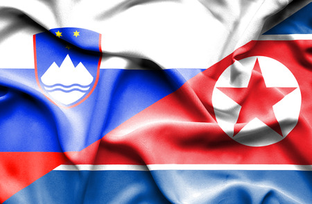slovenia: Waving flag of North Korea and Slovenia