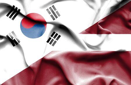 south korea: Waving flag of Latvia and South Korea