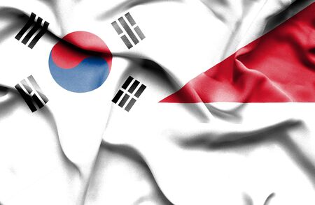 south korea: Waving flag of Monaco and South Korea Stock Photo