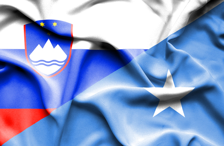 somalia: Waving flag of Somalia and Slovenia Stock Photo