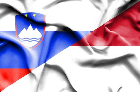slovenia: Waving flag of Monaco and Slovenia