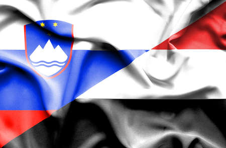 slovenia: Waving flag of Yemen and Slovenia Stock Photo