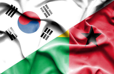 guinea bissau: Waving flag of Guinea Bissau and South Korea