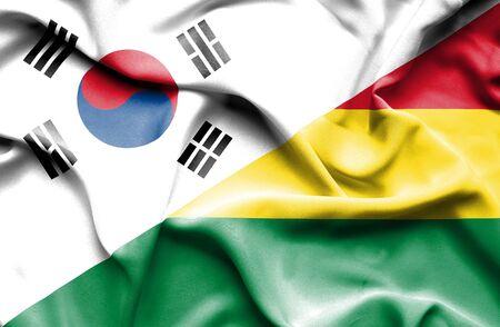 south korea: Waving flag of Bolivia and South Korea Stock Photo
