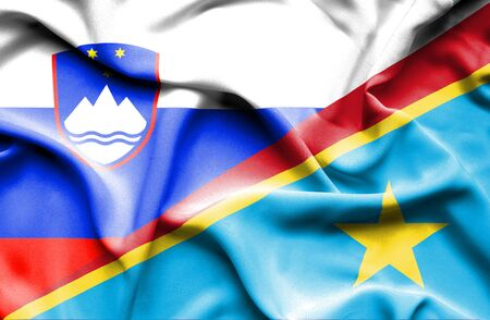 democratic: Waving flag of Congo Democratic Republic and Slovenia Stock Photo